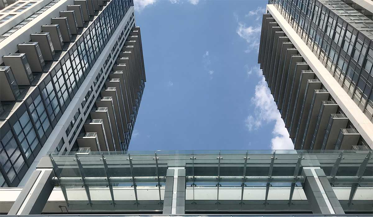 Exterior bottom-up image of IQ Condos Toronto.