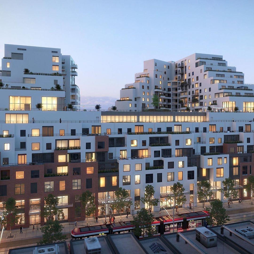 Exterior rendering of Queen & Ashbridge Condos building side at night.