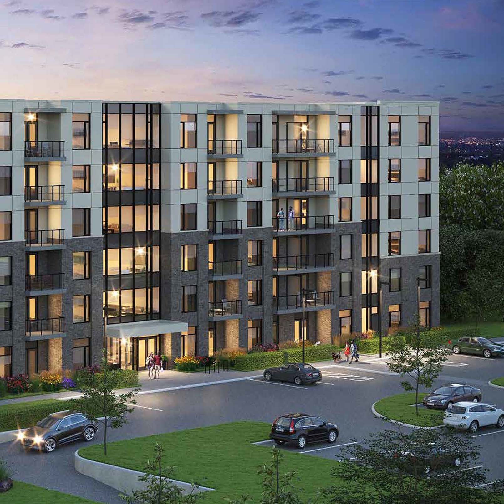 Rendering of Spur Line Common exterior at night and parking lot.