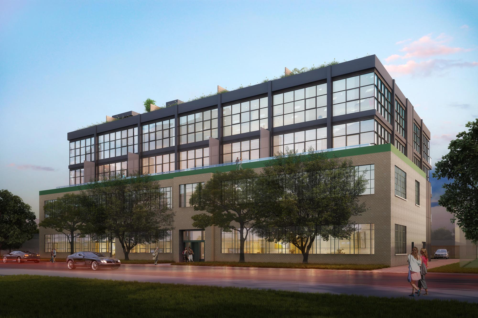 Rendering of Geary Factory Lofts exterior front at dusk.