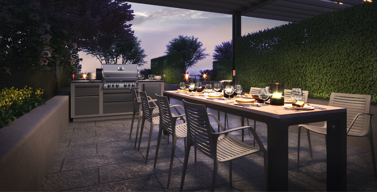 Rendering of Westerly Condos outdoor dining and bbq at night