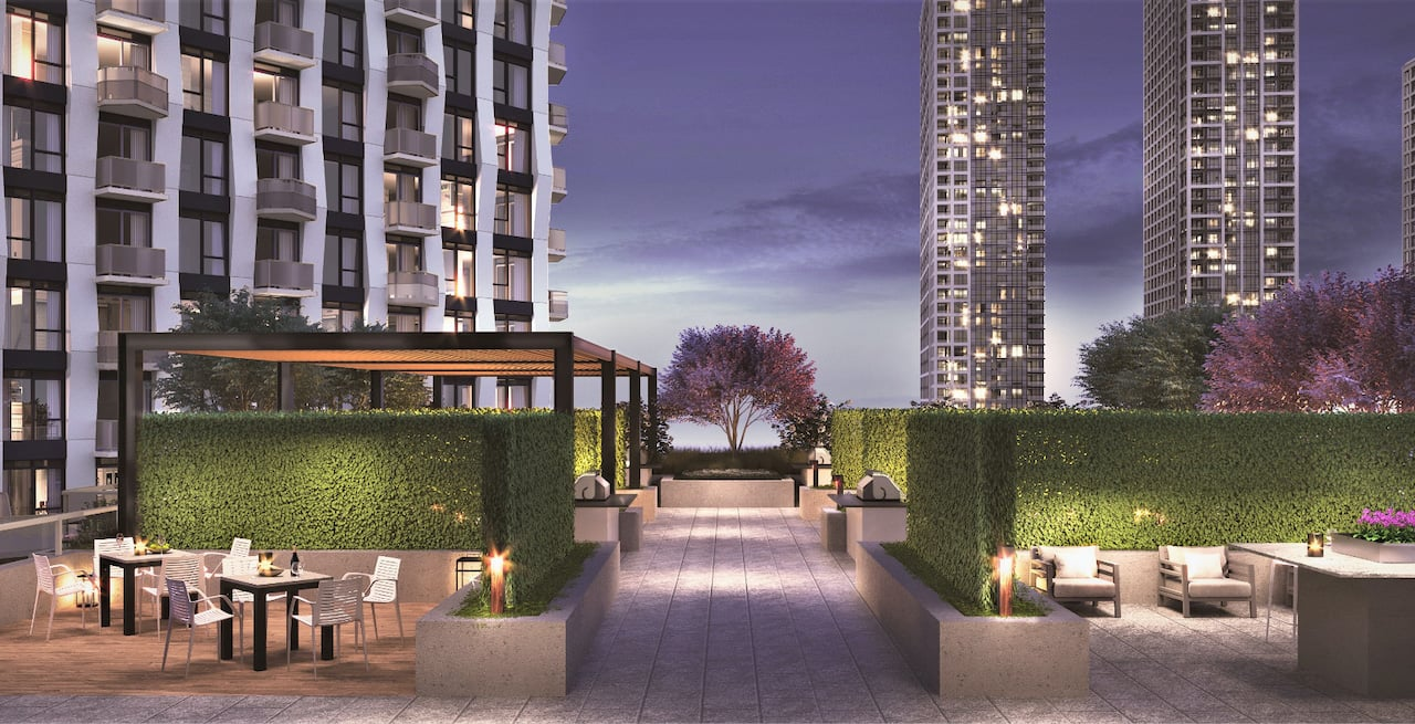 Rendering of Westerly Condos terrace with seating at night